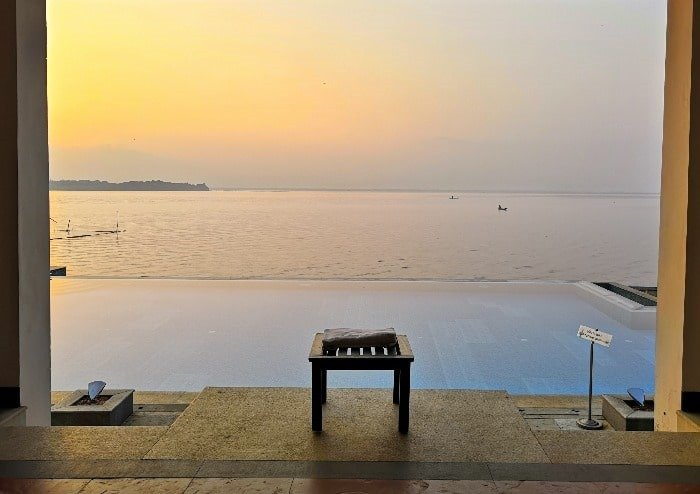 The infinity pool at sunrise, Lemon Tree Vembanad Lake Resort